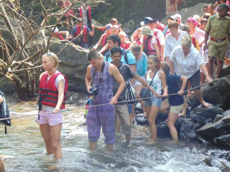 river crossing dudhsagar falls monsoon